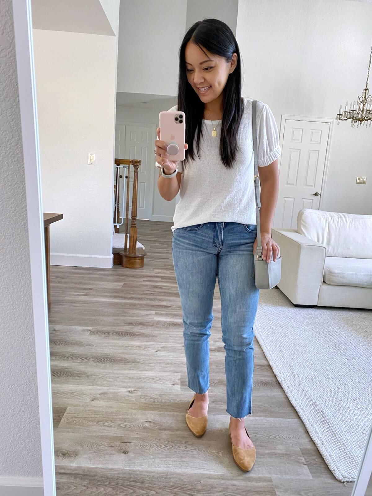Summer to Fall Transition Nicer Casual Outfit: white puff sleeve t-shirt + light wash straight leg jeans + tan suede flats + gold pendant necklace + gray crossbody purse