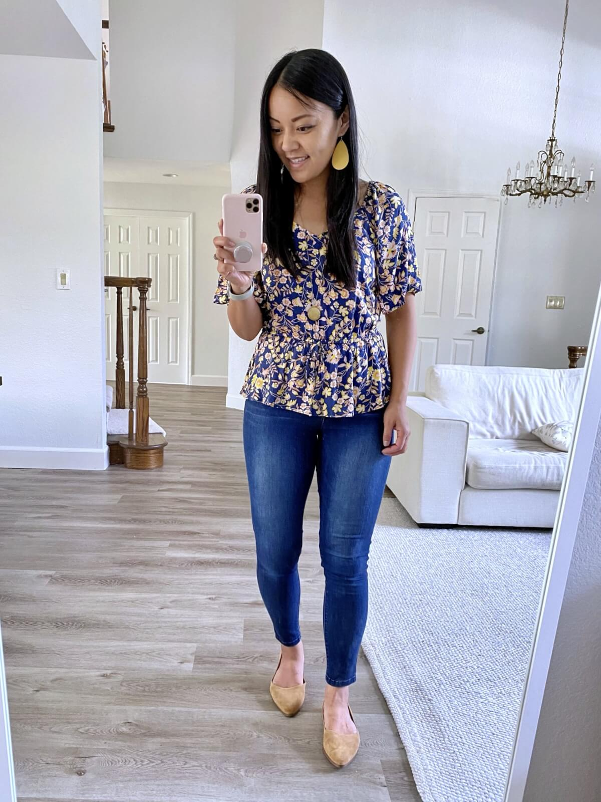 Elevated Casual Outfit: blue and yellow floral peplum top + blue ankle jeans + tan suede flats + yellow earrings + gold pendant necklace