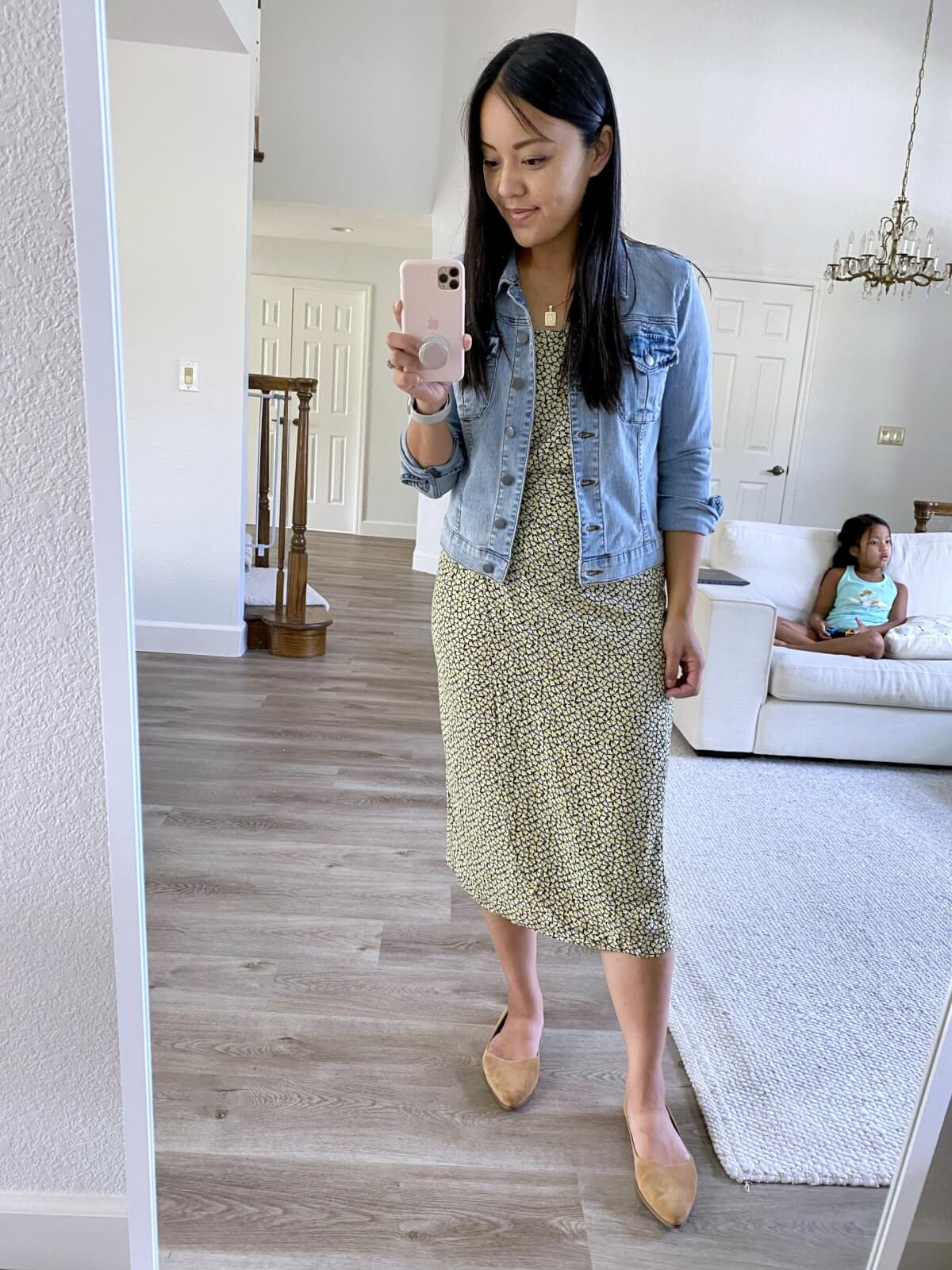 Dressy Casual Outfit: Amazon faux wrap blue and yellow print midi dress + light jean jacket + tan suede flats + gold pendant necklace