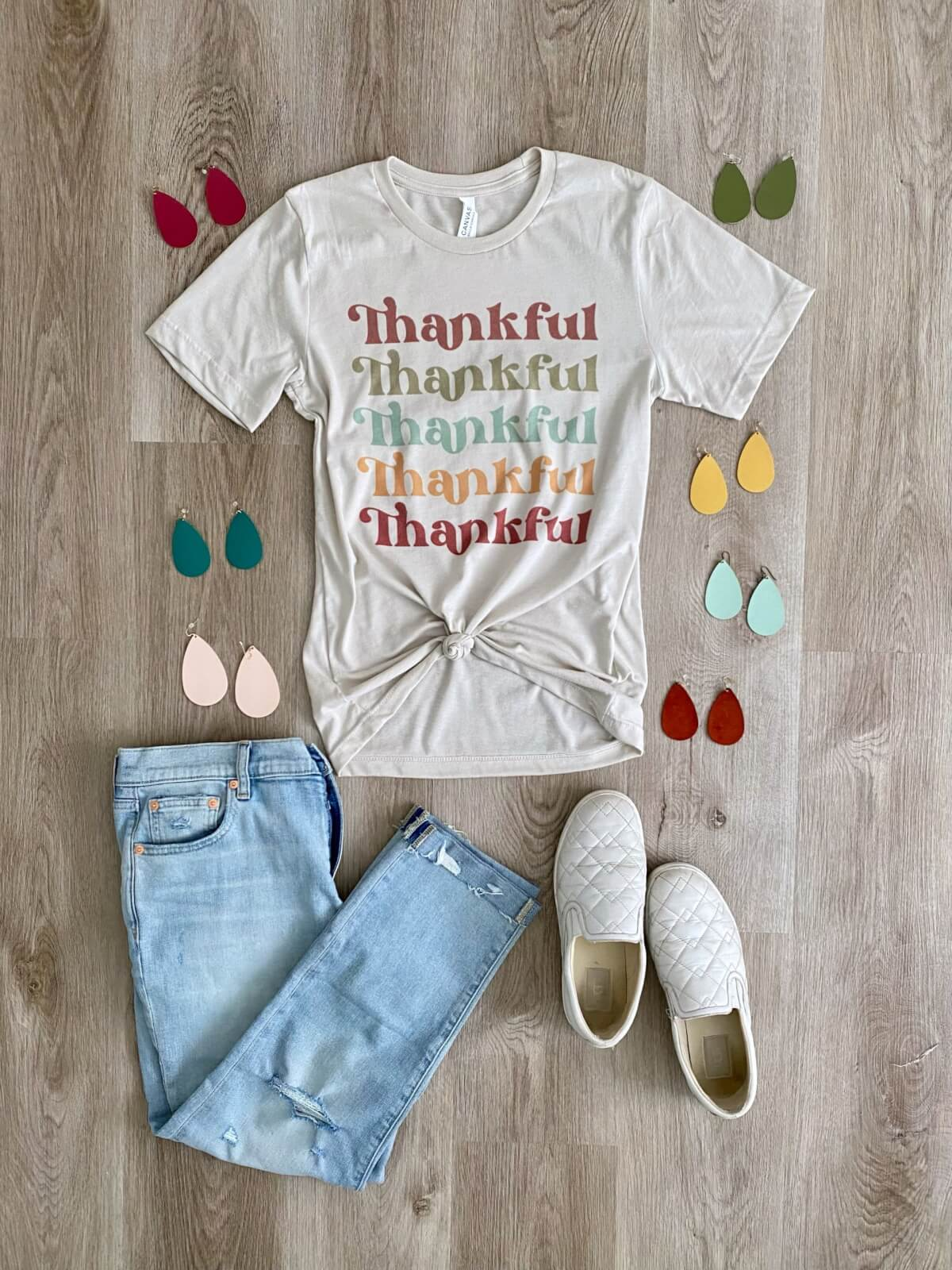 Casual Outfit Early Fall: thankful t-shirt + distressed jeans + Nickel & Suede earrings + white slip-on sneakers