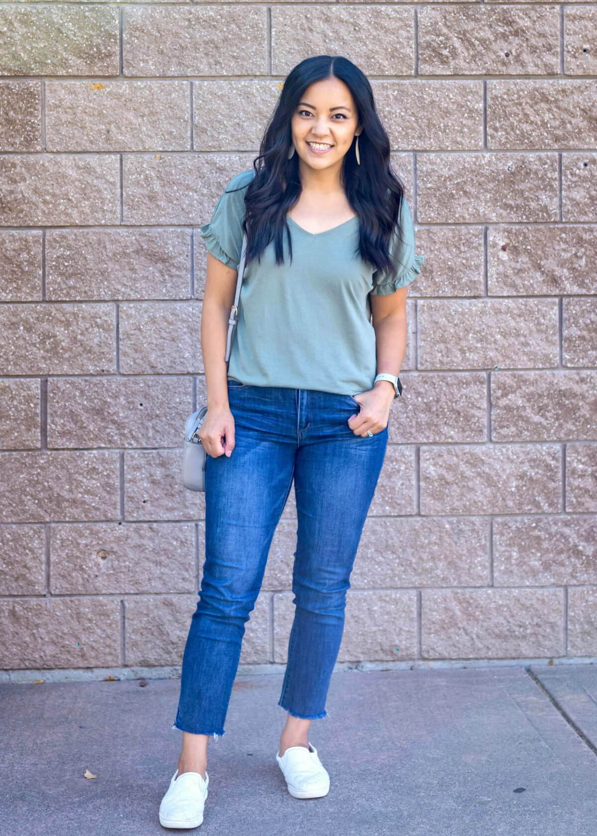 Casual Fall Outfit: sage green flutter sleeve tee + blue skinny crop jeans + white slip-on sneakers + white earrings + gray crossbody bag
