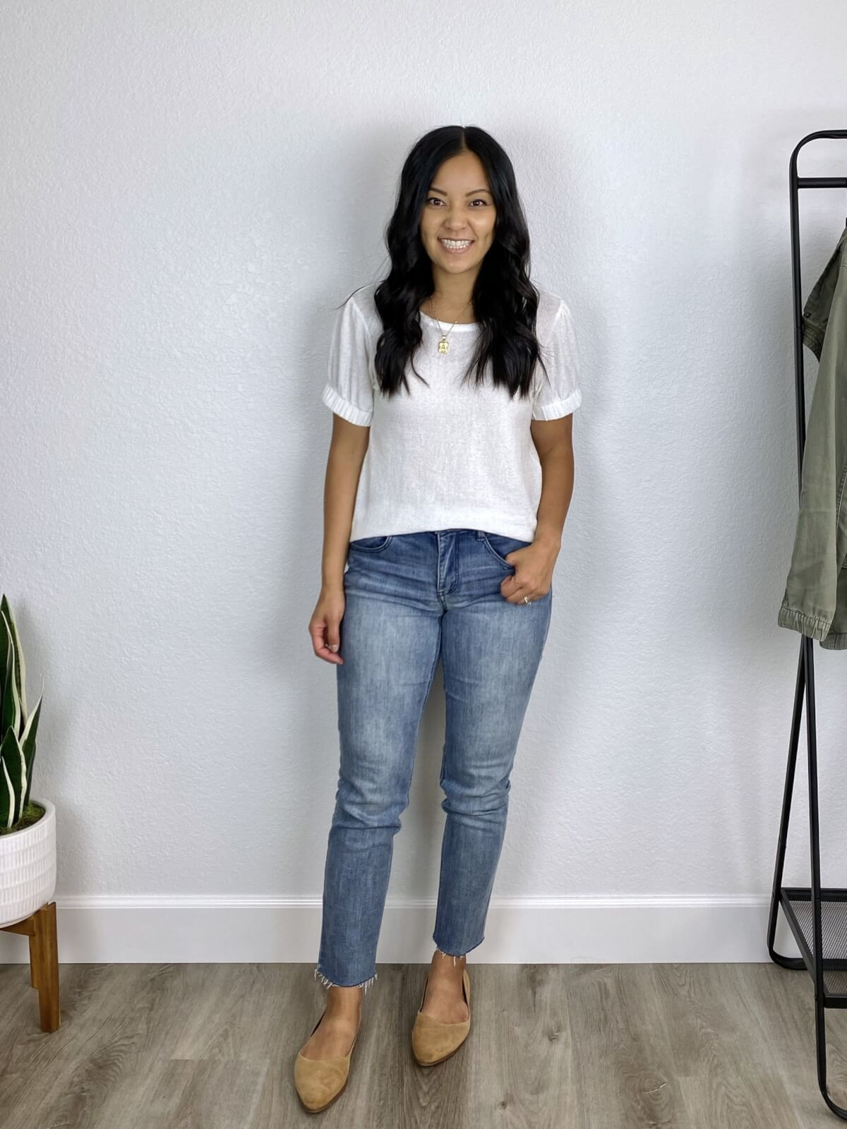Straight Leg Jeans Outfit for Fall: White puff sleeve t-shirt, light wash raw hem skinny jeans, tan suede flats, gold pendant necklace