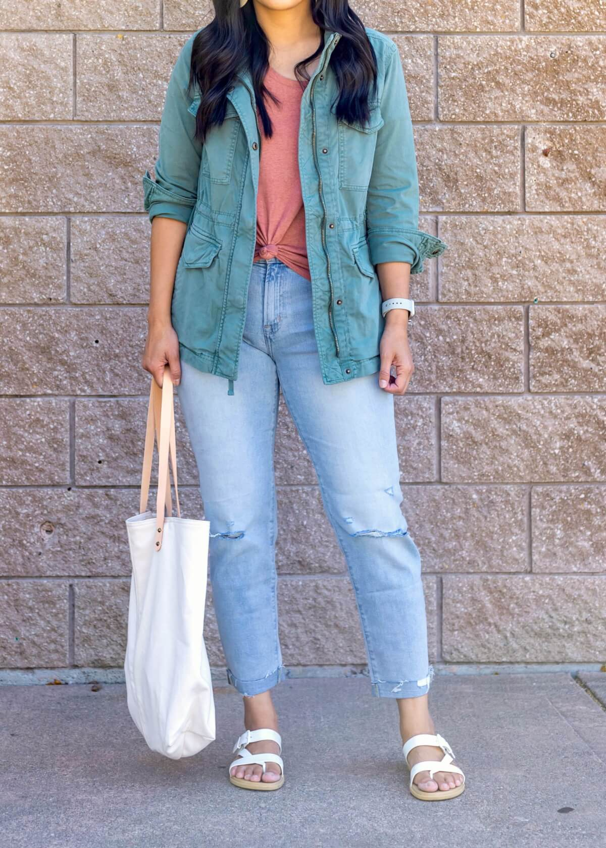 Casual Fall Outfit: pink tshirt + light wash distressed straight leg jeans + Gap green utility jacket + white footbed Crocs sandals + white canvas tote
